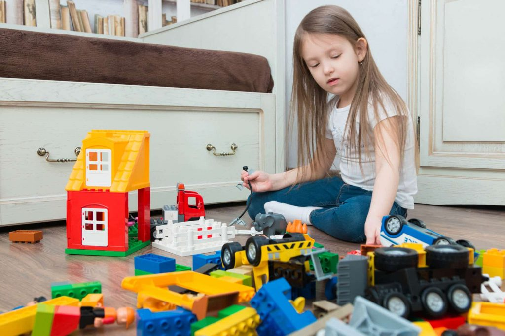 girl playing with STEM toys